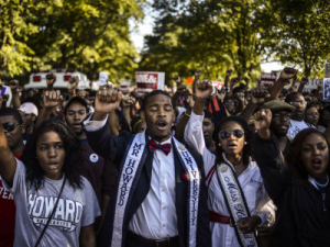 Students of Howard University march from campus to the Lincoln Memorial to participate in the Realize the Dream Rally for the 50th anniversary of the March on Washington