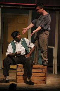 Jigger, played by senior Joe Schwalb tells Billy (William Toney) about stealing money.
