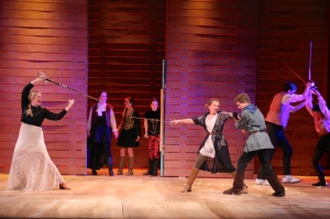 Capulet and Montague fight, while their husbands hold the women back