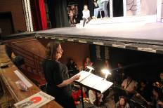 """Ms. Rebecca Renee Winnie conducting the Orchestra and performers during """"The Mikado"""""""