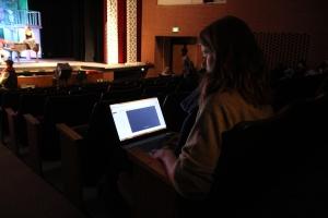 Alex typing up supertitles