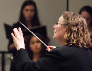 Ms. Winnie conducting Homestead Choirs
