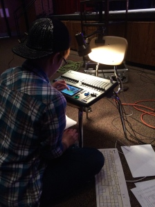 Tessa working with our Cognito board as she writes the light cues