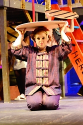 Andrea plays a theif in a barrel in one of the colorful stories