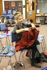"Emily fixing a costume she made for ""Around the World in 80 Days"""