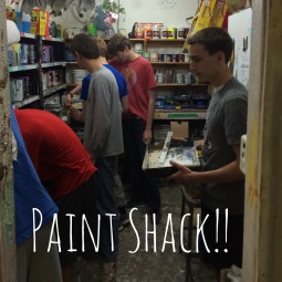 The men in the Paint Shack mixing paints and cleaning