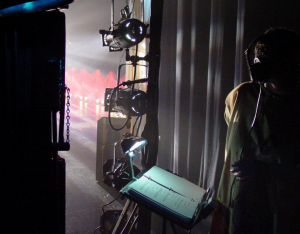 A stage manager is responsible for supervising the backstage crew of a theater or television production.